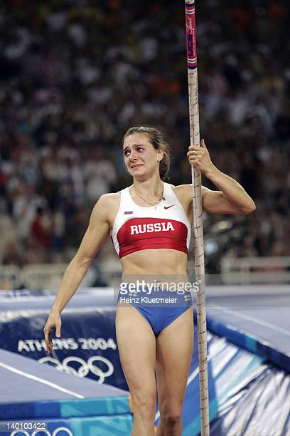 Summer Olympics: Russia Yelena Isinbayeva victorious after winning gold and setting new world record during Women's Pole Vault Final at Olympic...