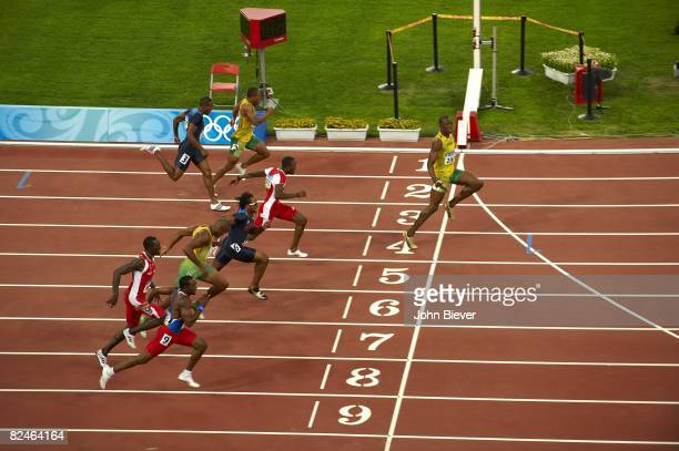 2008 Summer Olympics Aerial view of Jamaica Usain Bolt in action winning Men's 100M Final gold medal with world record time of 969 vs Trinidad Tobago...