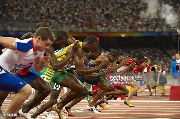 Summer Olympics: Jamaica Usain Bolt and Nigeria Obinna Metu in action during start of Men's 100M Round 2 Heats at National Stadium . Beijing, China...