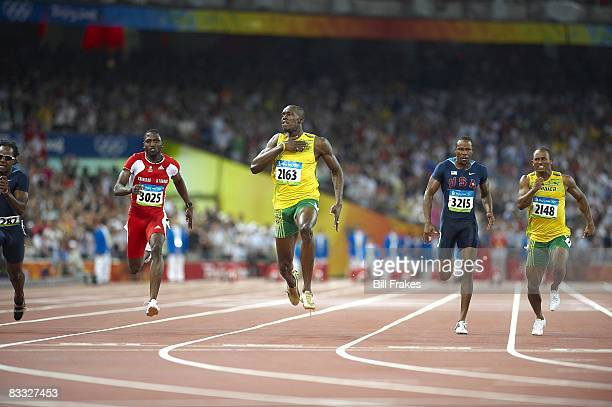 Summer Olympics: Jamaica Usain Bolt in action and victorious, winning Men's 100M Final gold medal with world record time of 9.69 vs Trinidad & Tobago...