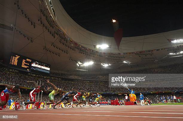 Summer Olympics: Jamaica Usain Bolt in action vs Trinidad & Tobago Richard Thompson and USA Walter Dix during start of Men's 100M Final at National...