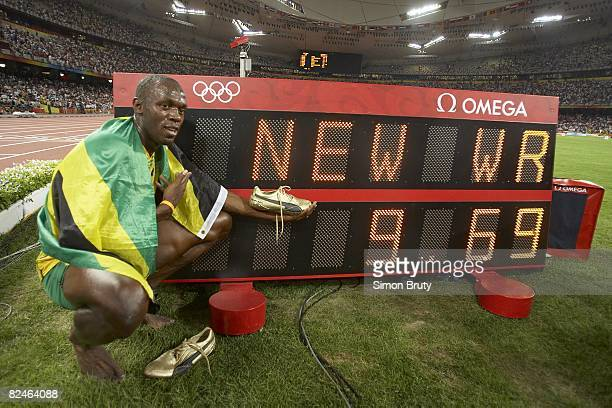 2008 Summer Olympics Jamaica Usain Bolt victorious with world record sign after winning Men's 100M Final gold medal with time of 969 at National...