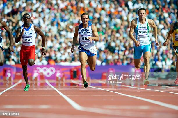 2012 Summer Olympics Cuba Leonel Suarez Czech Republic Roman Sebrle and Uzbekistan Rifat Artikov in action during Decathlon 100M at Olympic Stadium...