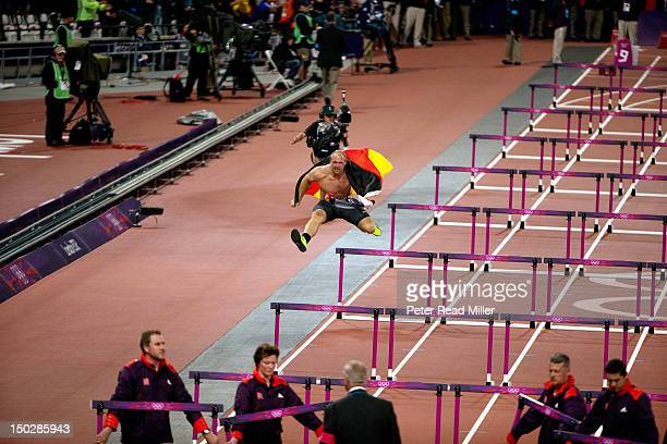 Summer Olympics: Germany Robert Harting victorious with national flag after winning gold during Men's Discus Final at Olympic Stadium. London, United...