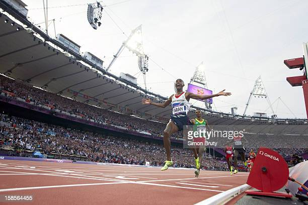 2012 Summer Olympics Great Britain Mohamed Farah victorious crossing finish line to win gold during Men's 5000M Final at Olympic Stadium View of...