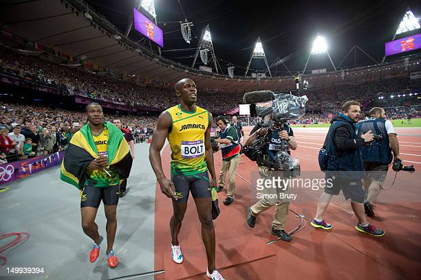 2012 Summer Olympics Jamaica Usain Bolt and Yohan Blake victorious after Men's 100M Final at Olympic Stadium Bolt sets new Olympic record London...