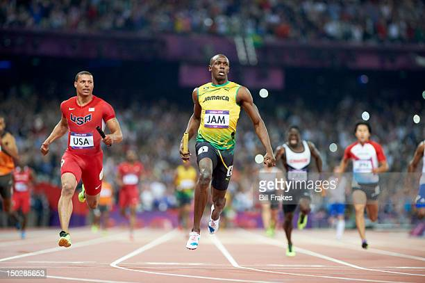 2012 Summer Olympics Jamaica Usain Bolt in action vs USA Ryan Bailey during Men's 4X100M Relay Final at Olympic Stadium Jamaica with World Record...