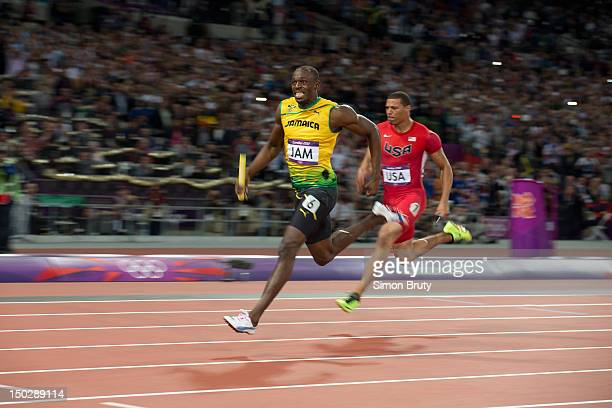 2012 Summer Olympics Jamaica Usain Bolt in action vs USA Ryan Bailey during Men's 4x100M Final at Olympic Stadium Jamaica wins gold with world record...