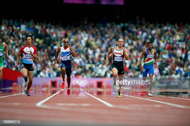 2012 Summer Olympics Japan Kei Takase Great Britain James Ellington and Canada Jared Connaughton in action during Men's 200M Heats at Olympic Stadium...