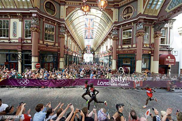 2012 Summer Olympics Kenya Abel Kirui and Wilson Kipsang Kiprotich Uganda Stephen Kiprotich in action during Men's Marathon at Leadenhall Market...