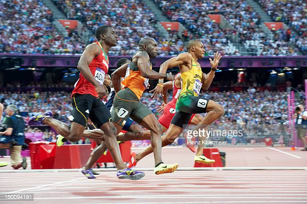 2012 Summer Olympics Saint Kitts and Nevis Antoine Adams Netherlands Churandy Martina and Jamaica Warren Weir in action during Men's 200M Semifinals...