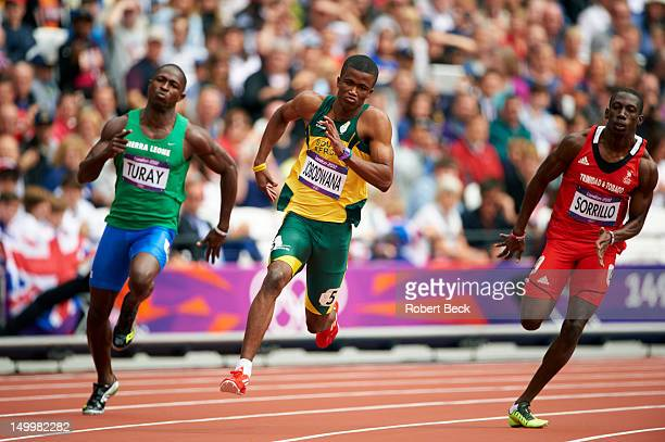 2012 Summer Olympics Sierra Leone Ibrahim Turay South Africa Anaso Jobodwana and Trinidad Tobago Rondel Sorrillo in action during Men's 200M Round 1...