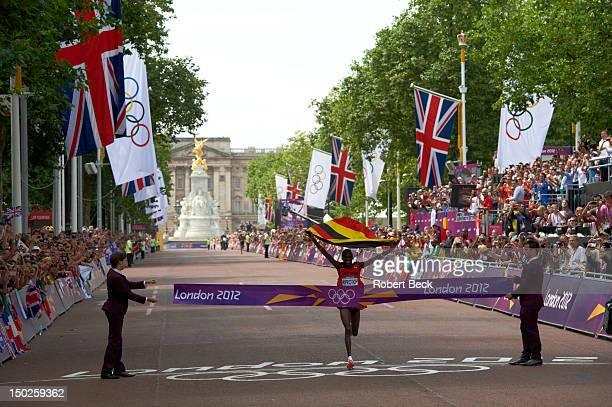 2012 Summer Olympics Uganda Stephen Kiprotich in action crossing finish line to win gold during Men's Marathon on The Mall London United Kingdom...