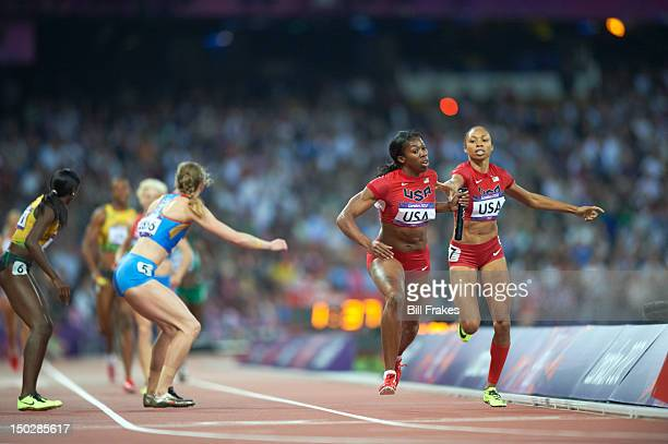 2012 Summer Olympics USA Allyson Felix in action handing off to USA Francena McCorory during Women's 4X400M Relay Final at Olympic Stadium USA wins...