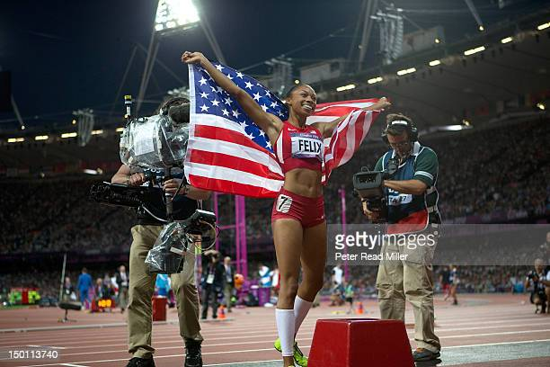 2012 Summer Olympics USA Allyson Felix victorious with American flag after winning Women's 200M Final gold at Olympic Stadium London United Kingdom...