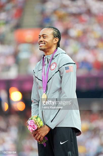 Summer Olympics: USA Aries Merritt victorious on medal stand after winning Men's 110M Hurdles Final gold at Olympic Stadium. London, United Kingdom...