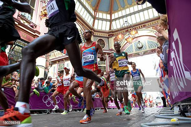 2012 Summer Olympics USA Mebrahtom Keflezighi Kenya Emmanuel Kipchirchir Mutai Eritrea Samuel Tsegay and Kenya Samuel Mokoka in action during Men's...