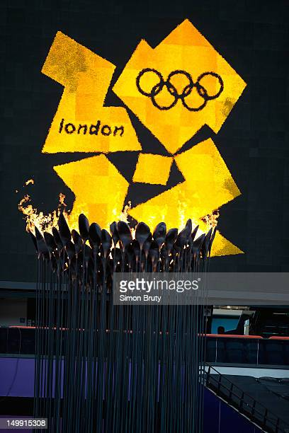 2012 Summer Olympics View of Olympic torch and cauldron in front of Olympic logo during evening session at Olympic Stadium London United Kingdom...