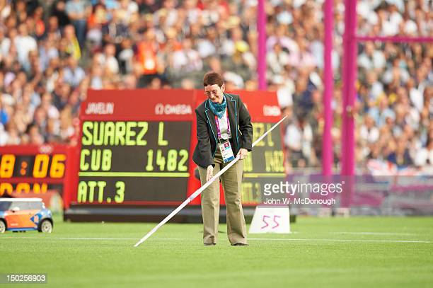 Summer Olympics: View of referee measuring distance of throw by Cuba Leonel during Decathlon Javelin Throw at Olympic Stadium. Suarez won bronze....