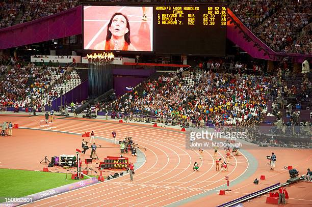 2012 Summer Olympics View of Russia Natalya Antyukh victorious on video screen after winning Women's 400M Hurdles Final gold at Olympic Stadium...
