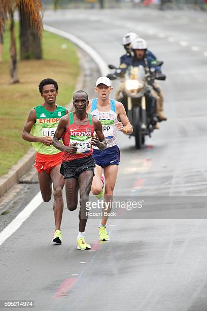 2016 Summer Olympics Ethiopia Feyisa Lilesa Kenya Eliud Kipchoge and USA Galen Rupp in action during the Men's Marathon Lilesa wins Silver Kipchoge...