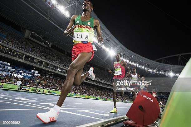2016 Summer Olympics Ethiopia Tamirat Tol Kenya Paul Kipngetich Tanui Great Britain Mohamed Farah USA Galen Rupp in action during Men's 10000M Final...