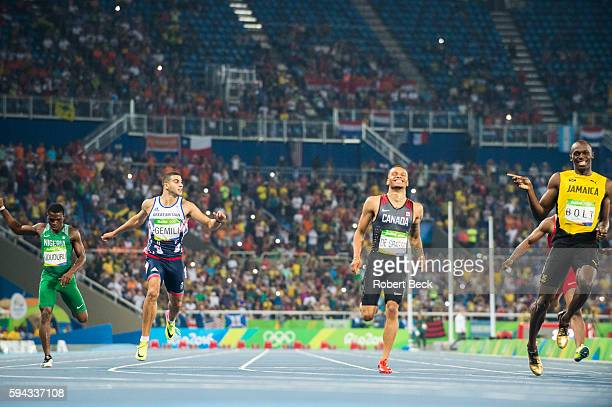 2016 Summer Olympics Great Britain Adam Gemili Canada Andre De Grasse Jamaica Usain Bolt in action crossing finish line during the Men's 200m...