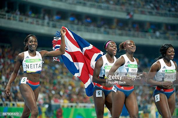 2016 Summer Olympics Great Britain Daryll Neita Desiree Henry Dina AsherSmith and Asha Philip victorious with flag after winning bronze medal in...
