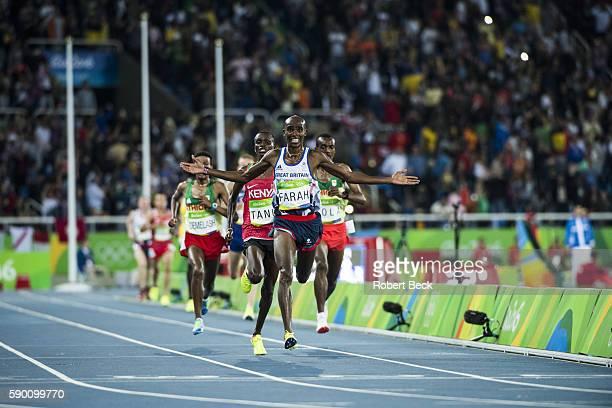 2016 Summer Olympics Great Britain Mohamed Farah Kenya Paul Kipngetich Tanui and Ethopia Tamirat Tola in action during Men's 10000M Final at Olympic...