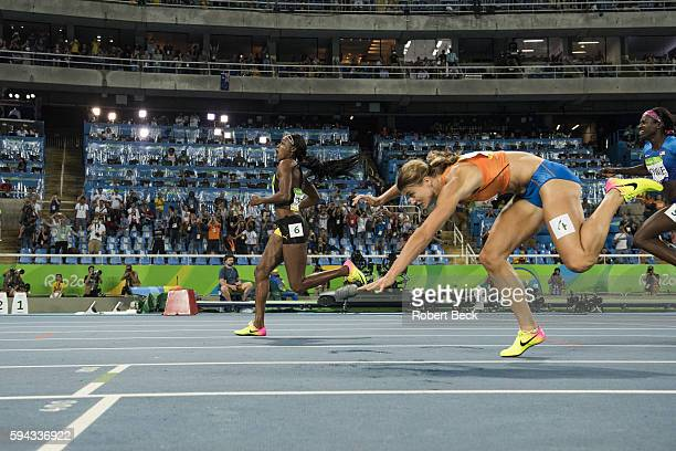 Summer Olympics: Jamaica Elaine Thompson, Netherlands Dafne Schippers in action, crossing finish line during the Women's 200m Final at the Olympic...