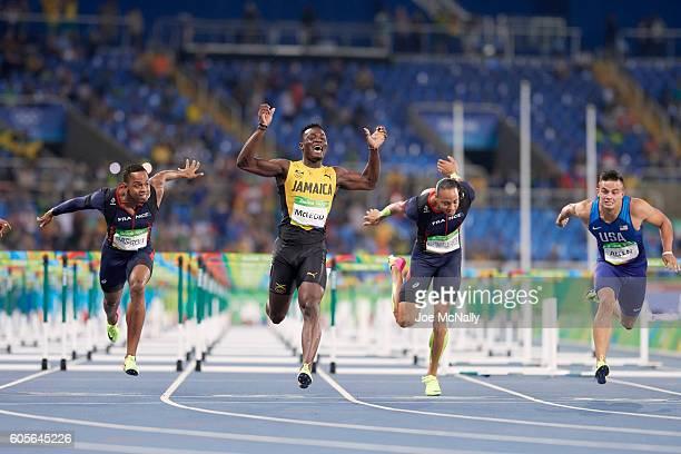2016 Summer Olympics Jamaica Omar McLeod France Dimitri Bascou France Pascal MartinotLagarde and USA Devon Allen in action crossing finish line...