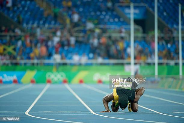 2016 Summer Olympics Jamaica Usain Bolt victorious kissing track after winning gold medal in Men's 4x100M Relay Final at Rio Olympic Stadium Rio de...