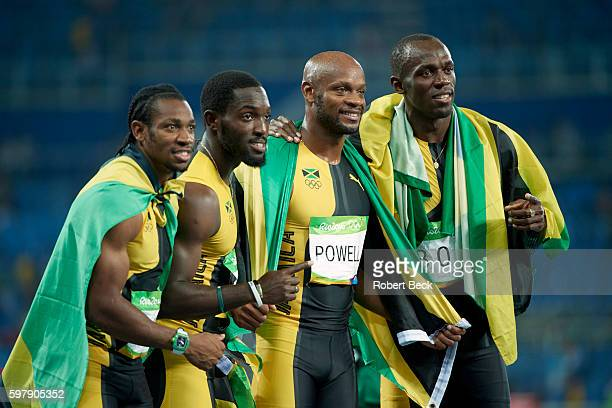 2016 Summer Olympics Jamaica Yohan Blake Nickel Ashmeade Asafa Powell and Usain Bolt victorous wearing Jamaican flags after winning gold medals in...