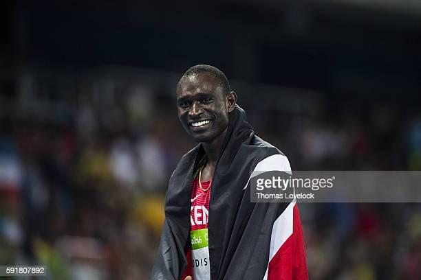2016 Summer Olympics Kenya David Rudisha victorious with Kenyan flag after winning Gold in the Men's 800M Final at the Olympic Stadium Rio de Janeiro...