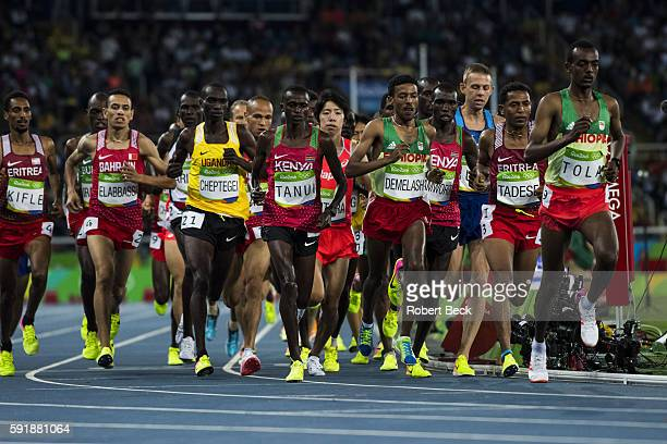 2016 Summer Olympics Kenya Paul Kipngetich Tanui and Ethiopia Tamirat Tola in action during Men's 10000M Final at Olympic Stadium Tinui wins silver...