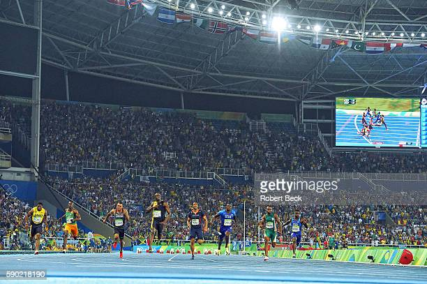Summer Olympics: Overall view of Jamaica Usain Bolt in action and victorious after crossing finish ahead of USA Justin Gatlin and Canada Andre De...