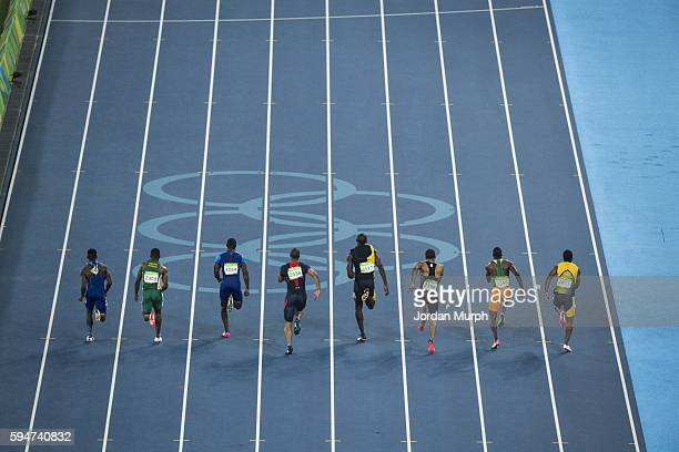 Summer Olympics: Rear view of athletes in action during the Men's 100m Final at the Olympic Stadium. Bolt wins Gold, Gatlin wins Silver, De Grasse...