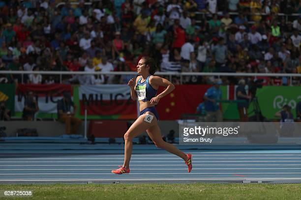 2016 Summer Olympics USA Abbey D'Agostino in action finishing race alone after fall during Women's 5000M Round 1 race at Rio Olympic Stadium...