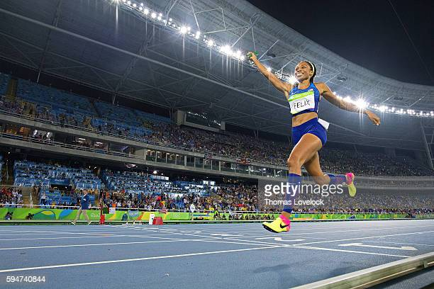 2016 Summer Olympics USA Allyson Felix in action and victorious crossing finish line after winning Women's 4x400M Relay Final at Riocentro Rio de...