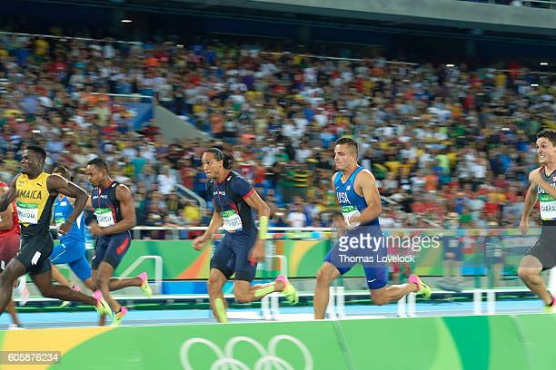 2016 Summer Olympics USA Devon Allen in action vs Jamaica Omar McLeod and France Pascal MartinotLagarde during Men's 110M Hurdles Final at Olympic...