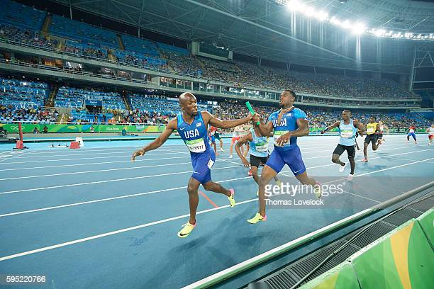 Summer Olympics: USA Gil Roberts in action, handing off to LaShawn Merrit during Men's 4x400M Relay Final at Riocentro. Rio de Janeiro, Brazil...