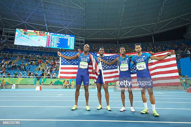2016 Summer Olympics USA LaShawn Merritt USA Gil Roberts USA Tony McQuay and Arman Hall victorious holding USA flags after winning gold in Men's...