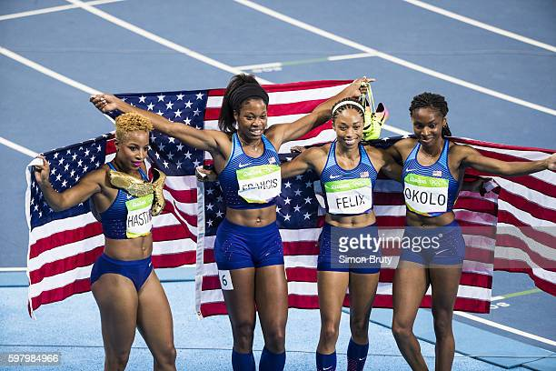 2016 Summer Olympics USA Natasha Hastings Phyllis Francis Allyson Felix and Courtney Okolo victorious holding up USA flags after winning gold medals...