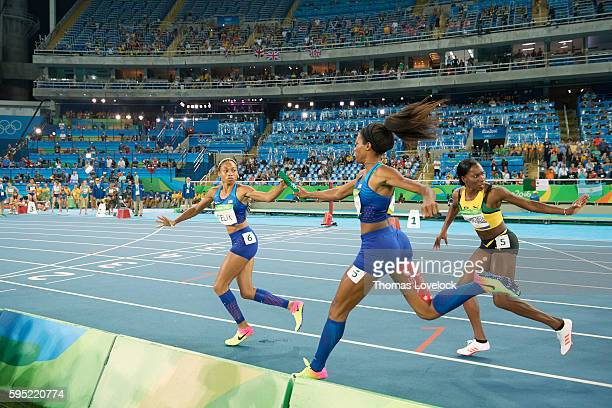 2016 Summer Olympics USA Phyllis Francis in action handing off to USA Allyson Felix during Women's 4x400M Relay Final at Riocentro Rio de Janeiro...