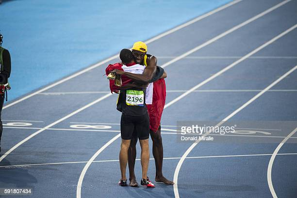 Summer Olympics: View of Canada Andre De Grasse hugging Jamaica Usain Bolt after the Men's 100m Final at the Olympic Stadium. Bolt wins Gold, De...