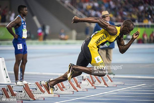 2016 Summer Olympics View of Jamaica Usain Bolt in action practice start before Men's 100M Final at the Olympic Stadium Rio de Janeiro Brazil...