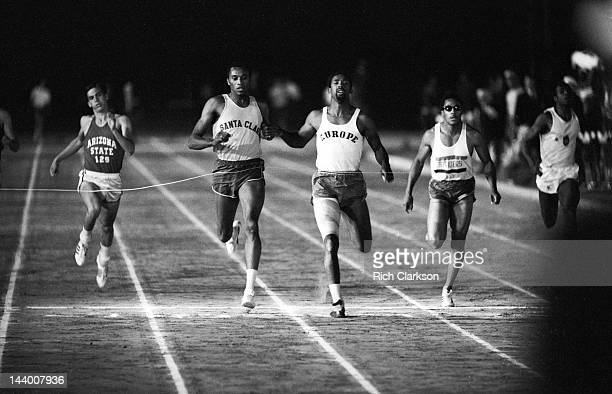National Championships: Europe John Carlos in action, crossing finish line and winning race vs Santa Clara Tommie Smith at Hughes Stadium on...