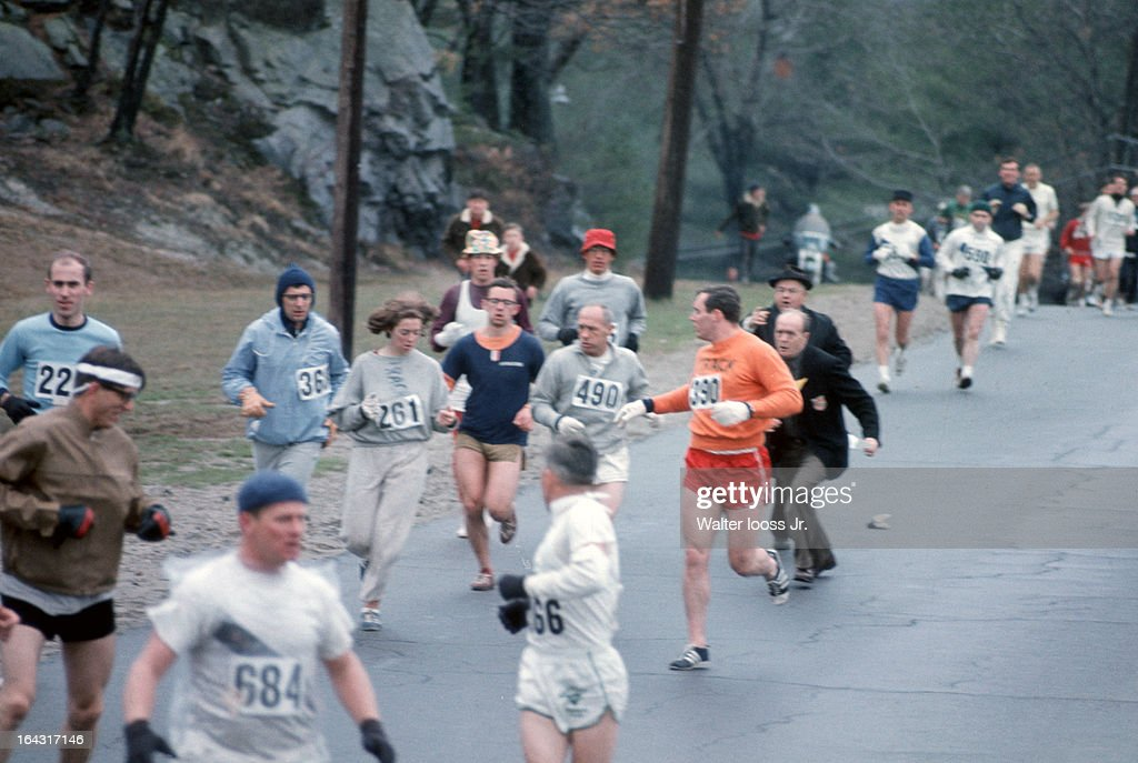 USA Kathrine Switzer (261) in action as BAA co-director Jock Semple attempts to tear off Switzer's bib during race on Union Street. Switzer's boyfriend Tom Miller (390) blocks Semple. Women were not officially included in the race until 1972. Walter Iooss Jr. F6 )