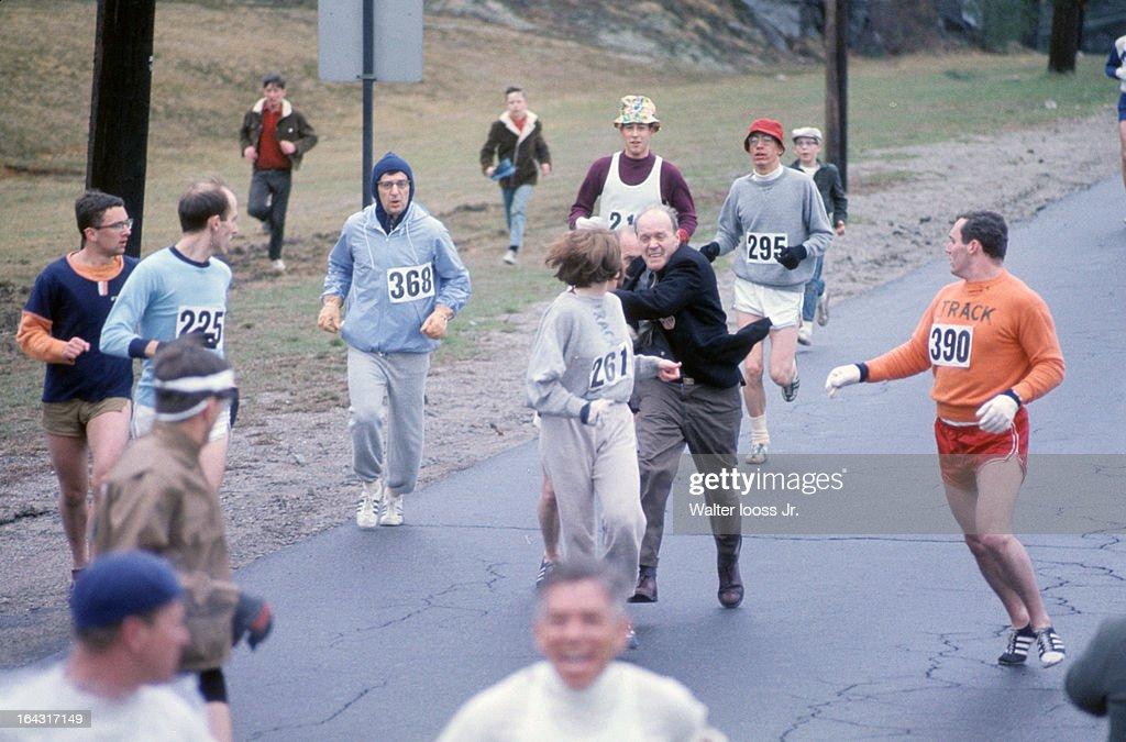 USA Kathrine Switzer (261) in action as BAA co-director Jock Semple attempts to tear off Switzer's bib during race on Union Street. Switzer's boyfriend Tom Miller (390) blocks Semple. Women were not officially included in the race until 1972. Walter Iooss Jr. F7 )