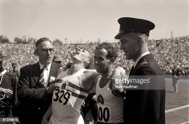 Track Field British Empire and Commonwealth Games Closeup of GBR Roger Bannister and AUS John Landy after mile race Vancouver CAN 8/2/1954